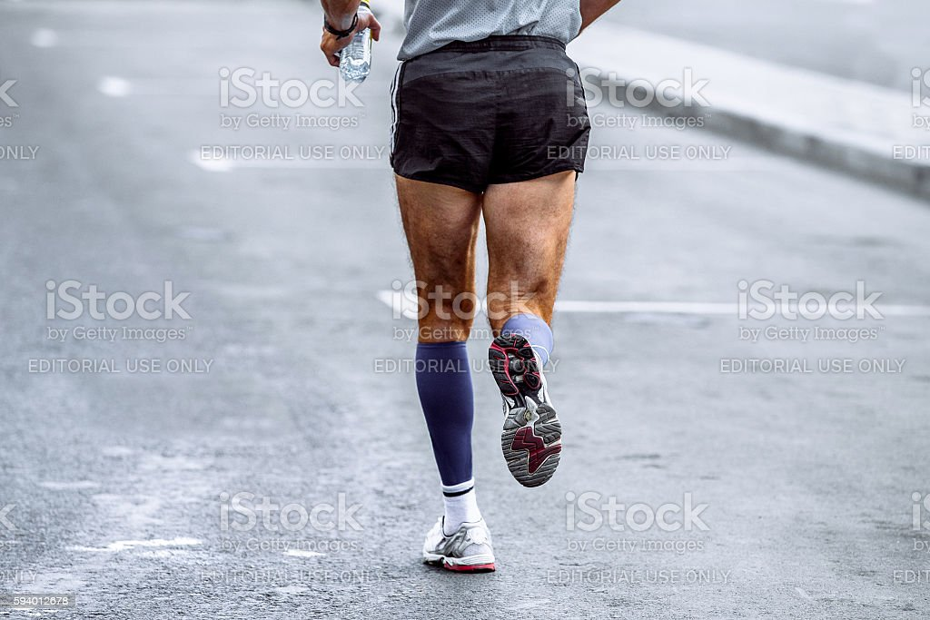 rear view of male athlete running marathon royalty-free 스톡 사진