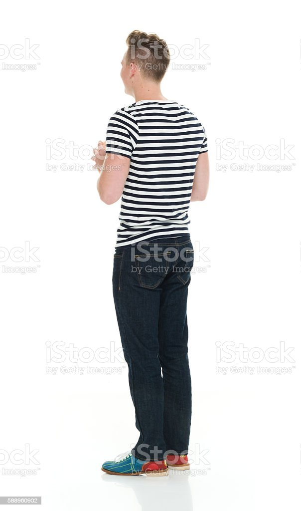 Rear view of male holding bowling bal stock photo