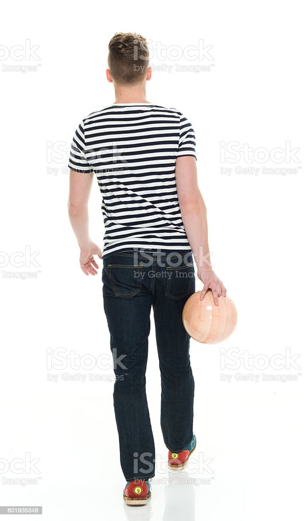 Rear view of male holding bowling ball stock photo