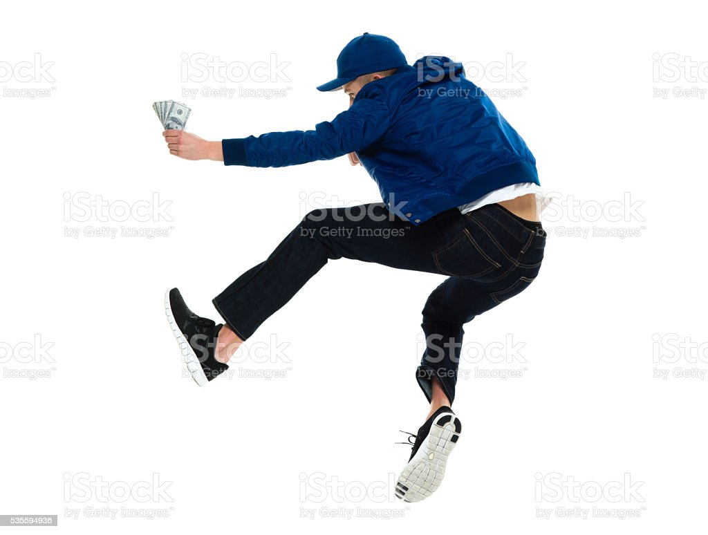 Rear view of male jumping with money stock photo