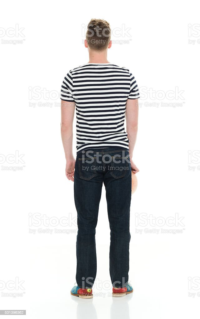 Rear view of man holding bowling ball stock photo