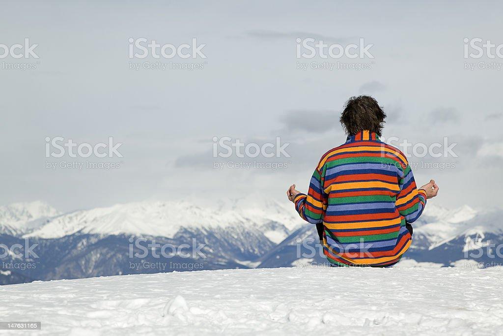 Rear view of man meditating on mountain peak (XXXL) royalty-free stock photo