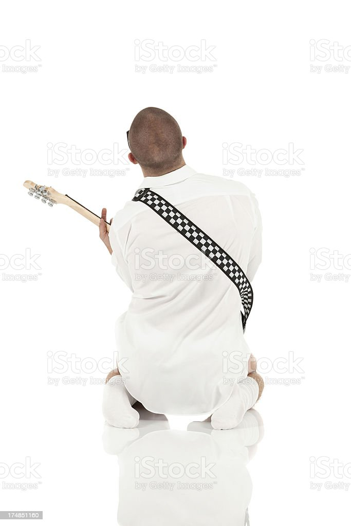 Rear view of man playing a guitar royalty-free stock photo