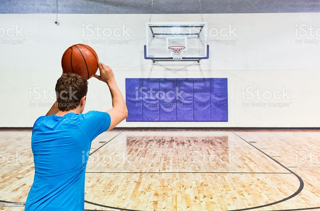 Rear view of man playing basketball stock photo