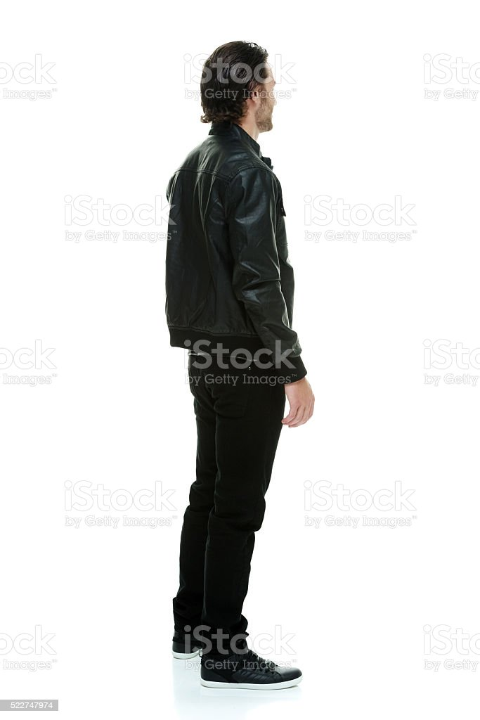 Rear view of man standing and looking away stock photo