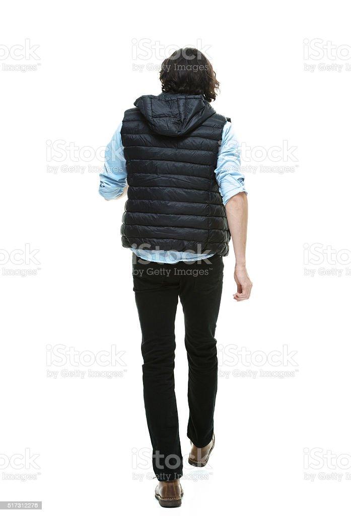 Rear view of man walking stock photo