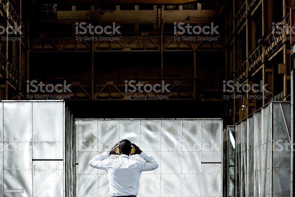 Rear view of man wearing ear defenders stock photo