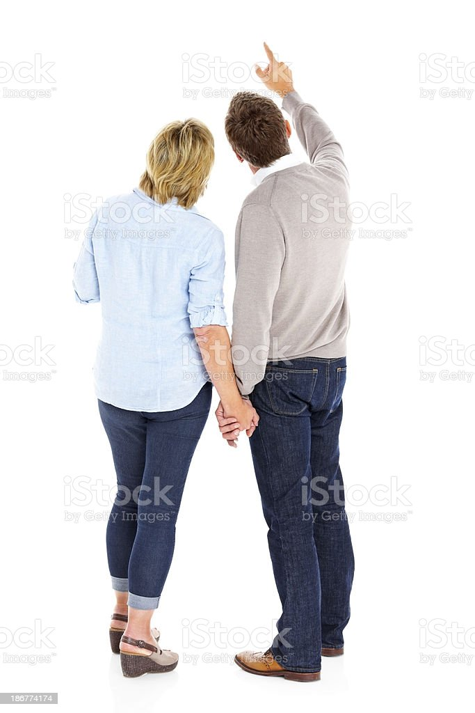 Rear view of mature couple looking at something interesting stock photo