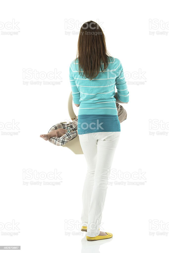 Rear view of mother holding baby basket stock photo