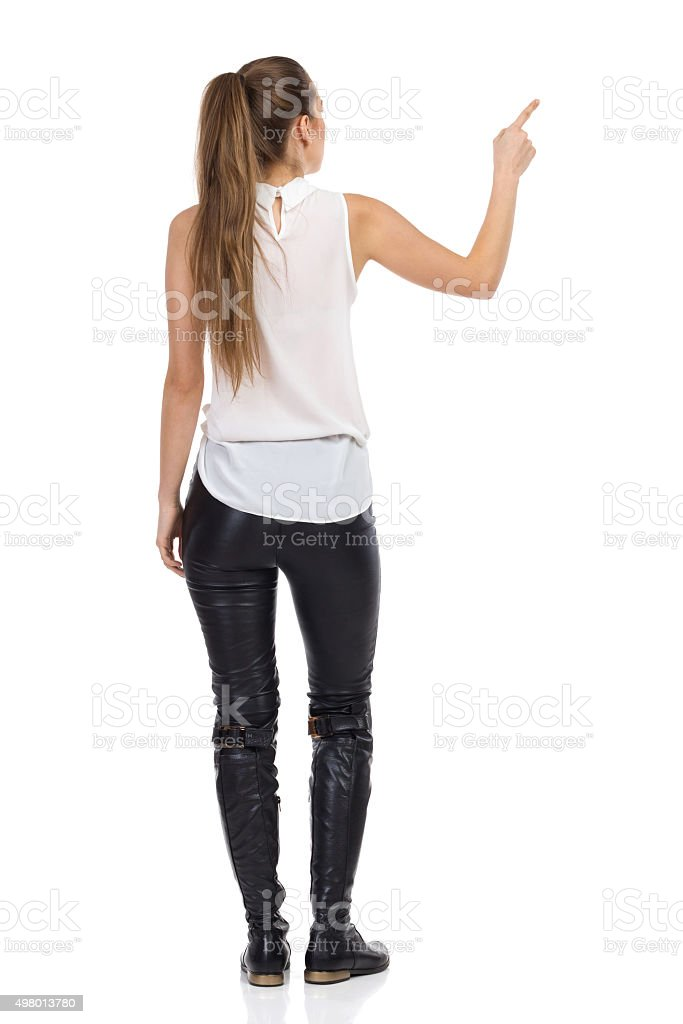 Rear View Of Pointing Woman stock photo