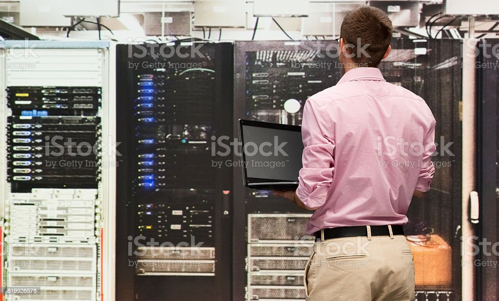Rear view of programmer working stock photo