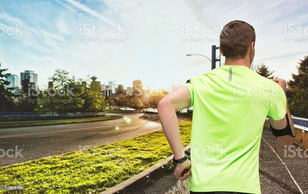 Rear view of runner running outdoor stock photo