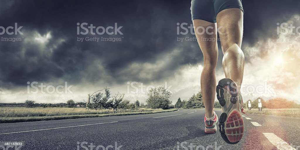 Rear View of Runners Legs stock photo