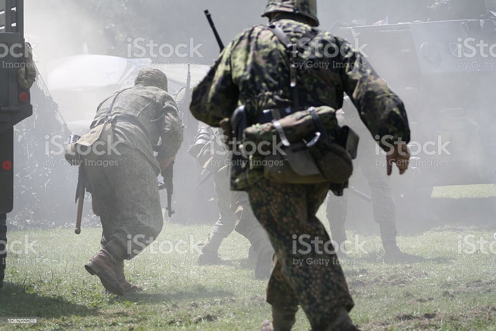 Rear View of Soldiers Running royalty-free stock photo