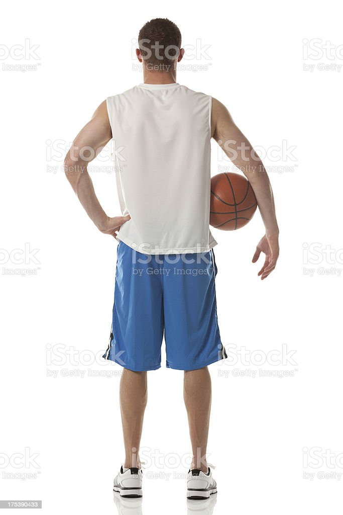 Rear view of sportsman holding a basketball stock photo