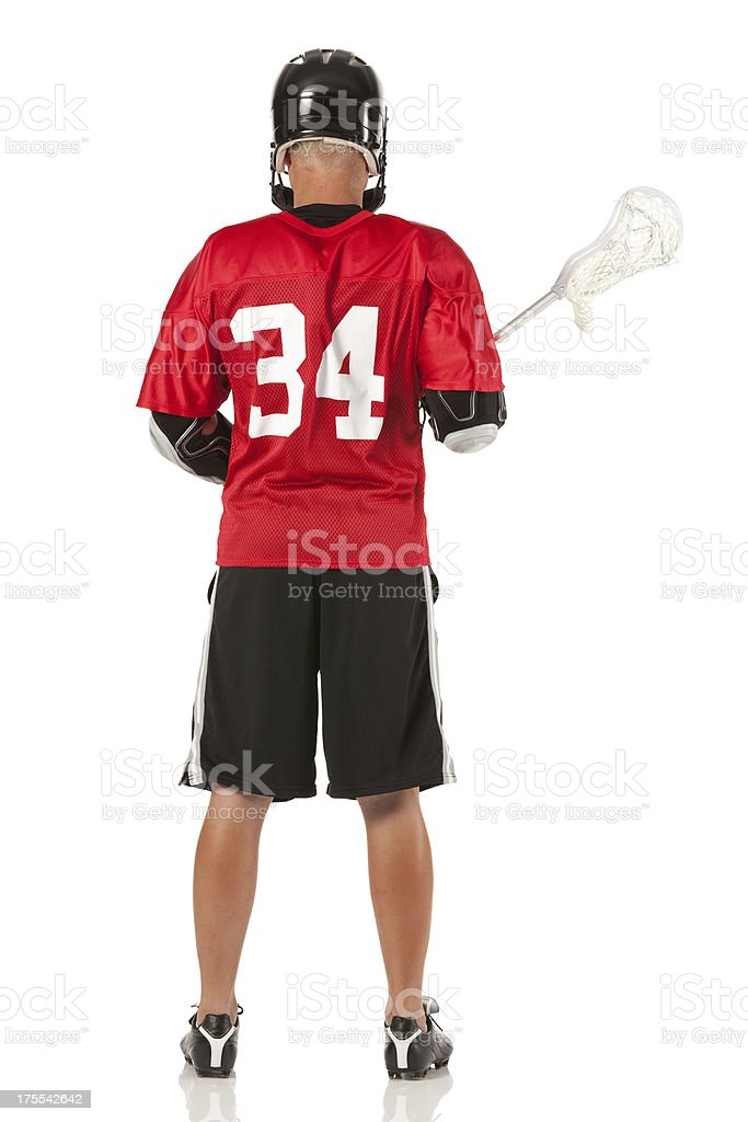 Rear view of sportsman holding a lacrosse stick stock photo