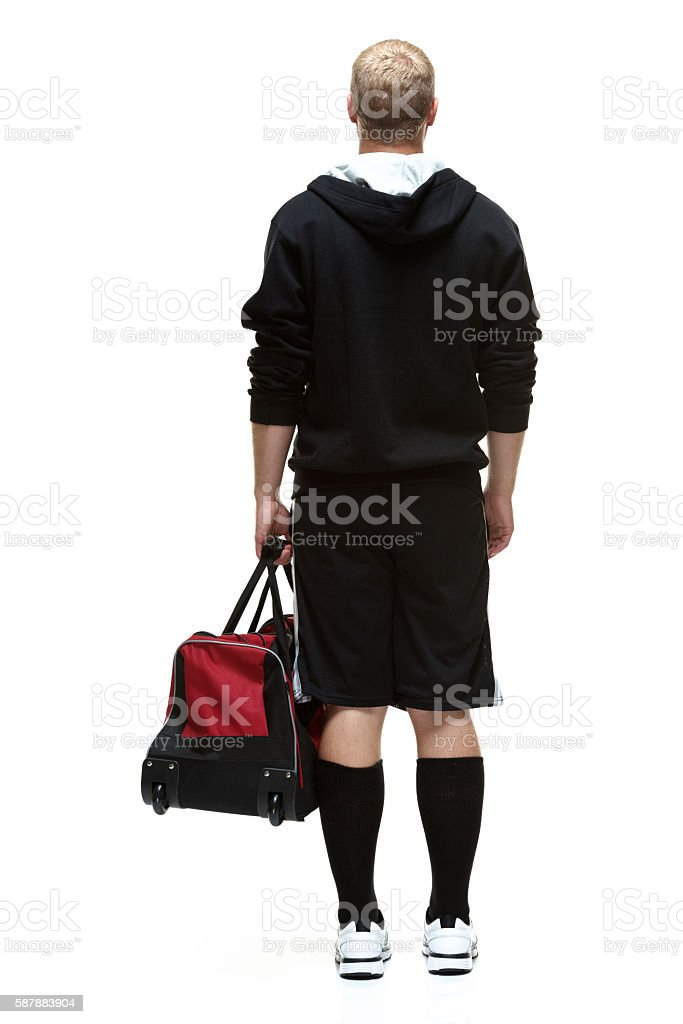 Rear view of student standing stock photo