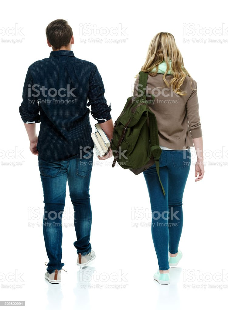 Rear view of students walking stock photo