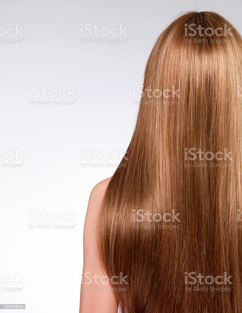 Rear view  of the woman with long  hair stock photo