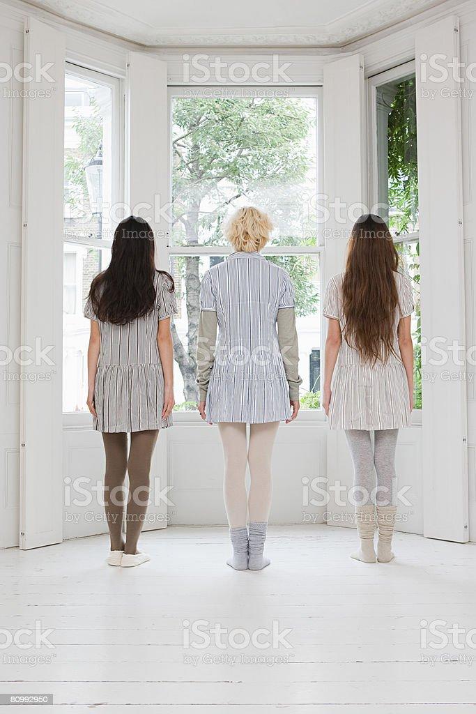 Rear view of three women stock photo