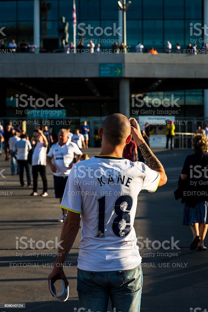 Rear view of Tottenham Hotspur supporter outside Wembley Stadium, London stock photo