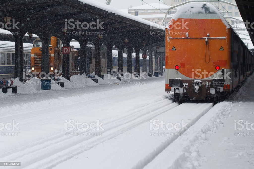 Rear view of train in railway station in winter time stock photo