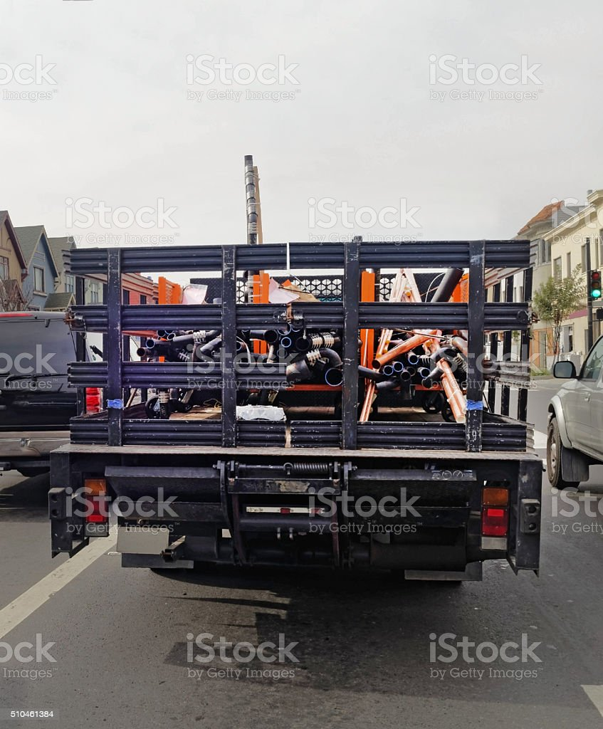 Rear View of Truck Delivering Pipes stock photo