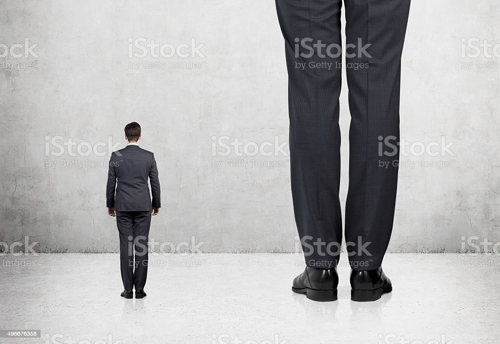 Rear view of two professionals stock photo