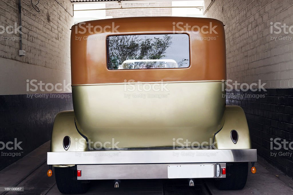 Rear view of vintage car standing in garage stock photo