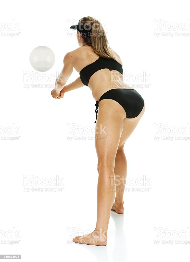 Rear view of volleyball player bumping stock photo