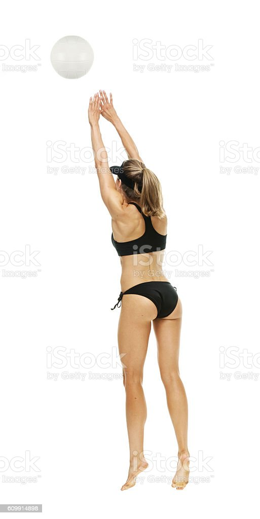 Rear view of volleyball player playing stock photo