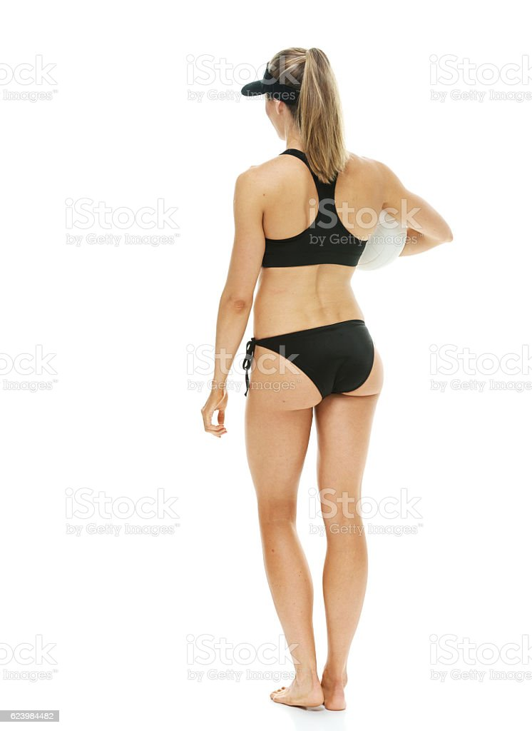 Rear view of volleyball player standing stock photo