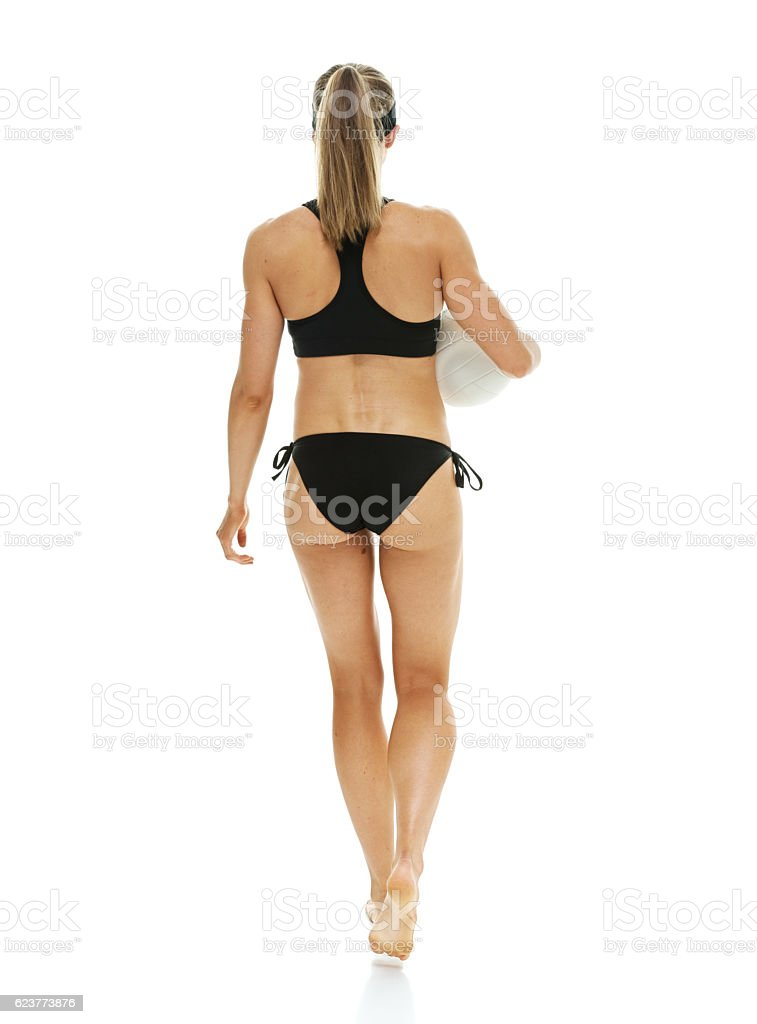 Rear view of volleyball player walking stock photo