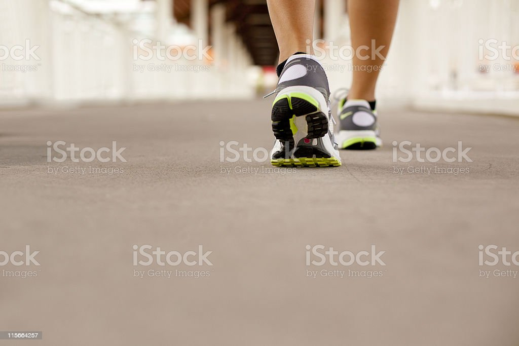 Rear view of walking sport shoes royalty-free stock photo