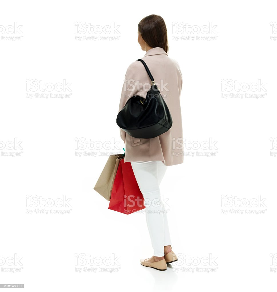 Rear view of woman holding shopping bag stock photo