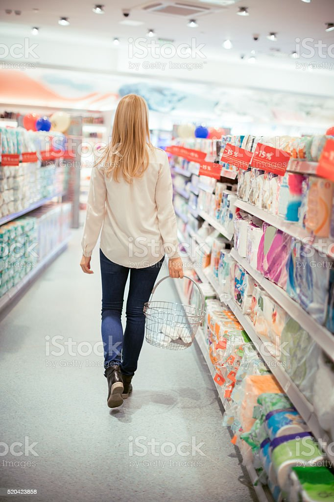Rear view of woman in supermarket stock photo