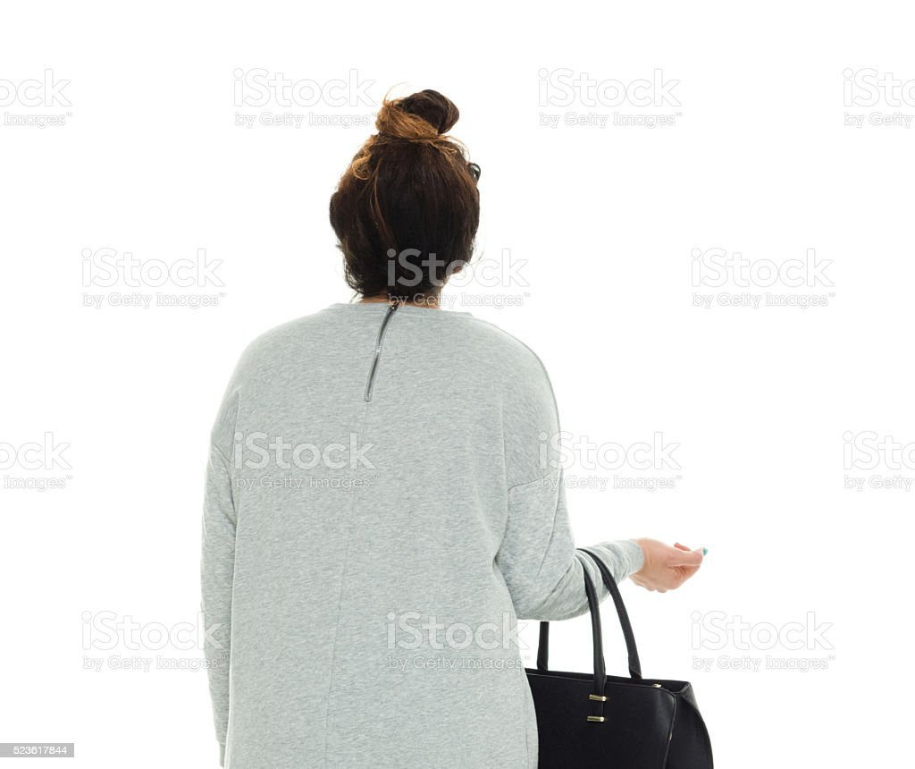 Rear view of woman looking away stock photo