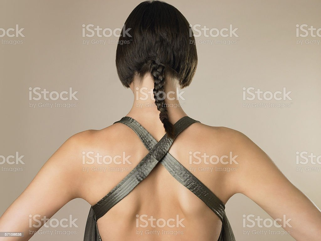 Rear view of woman with braid stock photo
