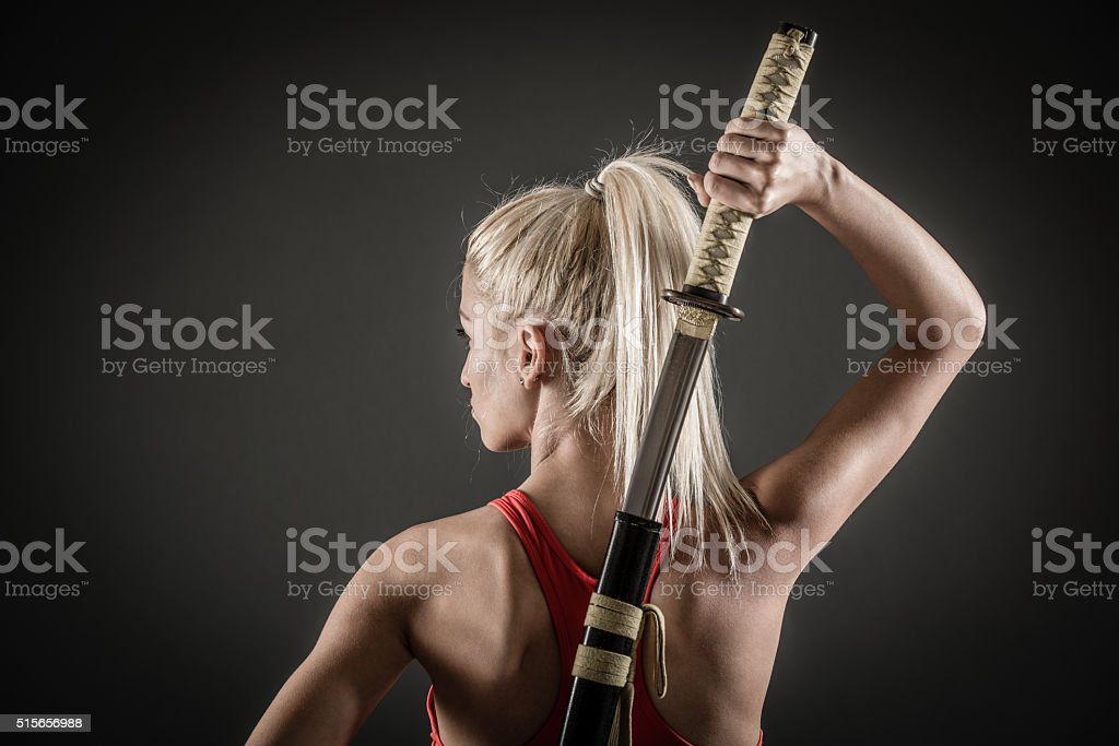Rear View Of  Woman With Sword stock photo
