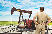 Rear view of worker standing in oil industry