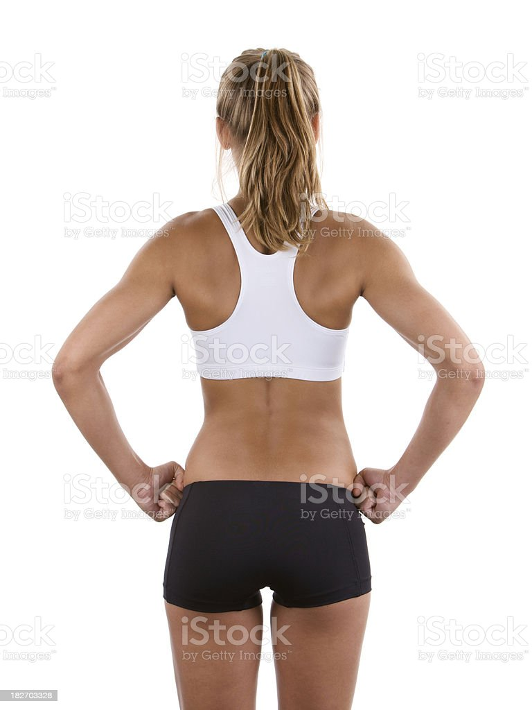Rear view of young athletic woman stock photo