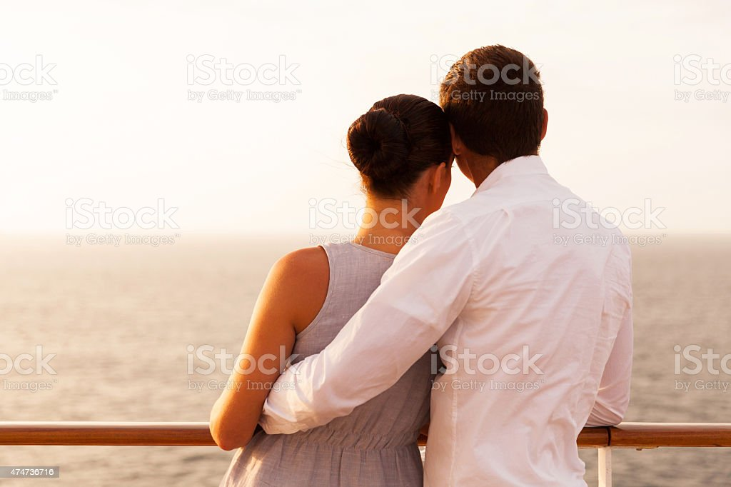rear view of young couple on cruise vacation stock photo