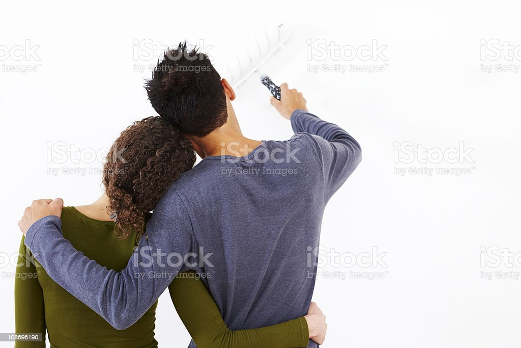 rear view of young couple painting wall royalty-free stock photo