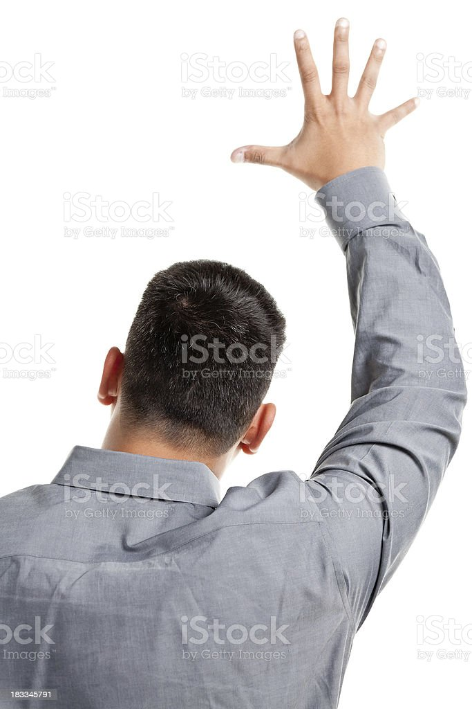 Rear View Of Young Man Raising Hand stock photo