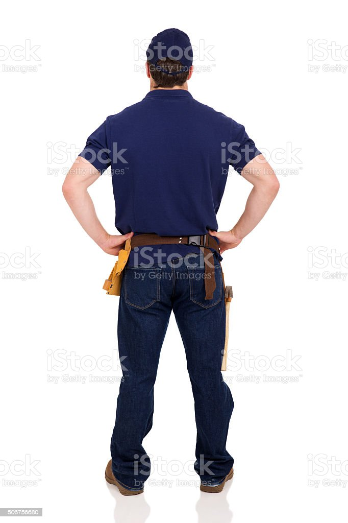 rear view of young repairman stock photo