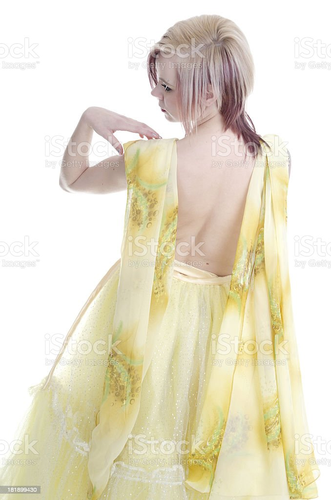 Rear view of young woman in scarf and sparkly skirt. royalty-free stock photo