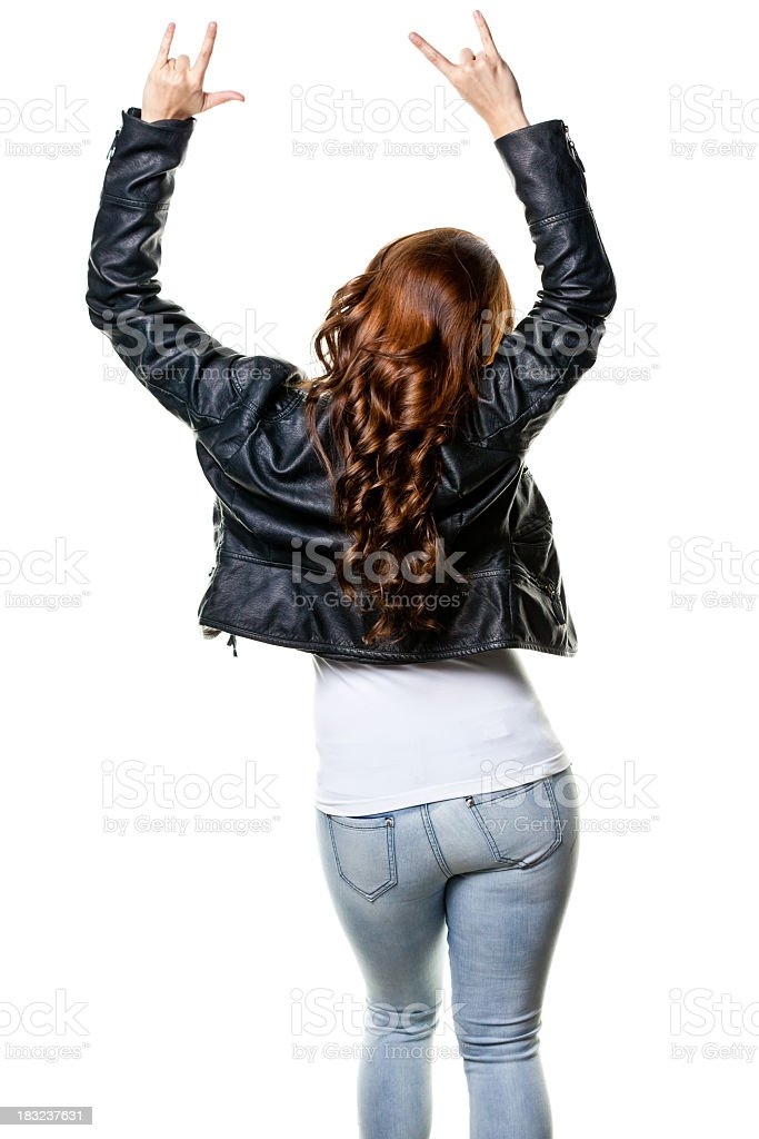 Rear View of Young Woman With Arms Up Gesturing stock photo