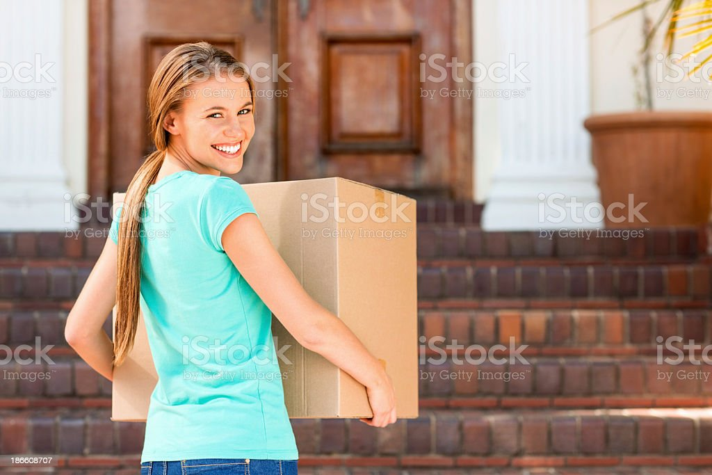 Rear view portrait student moving into dormitory stock photo