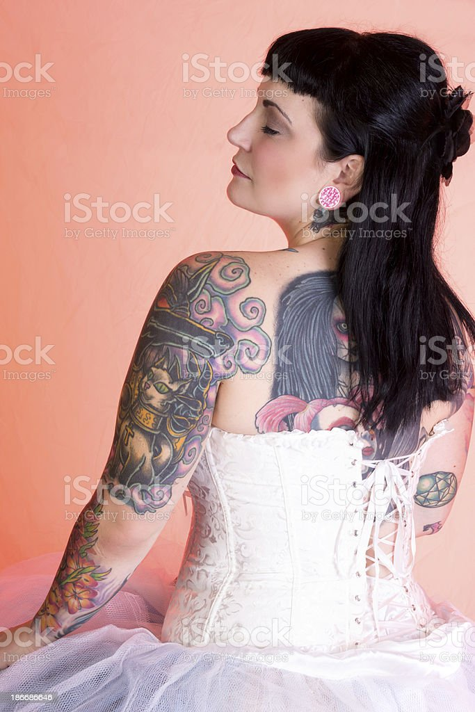 Rear view profile of tattooed pinup model stock photo