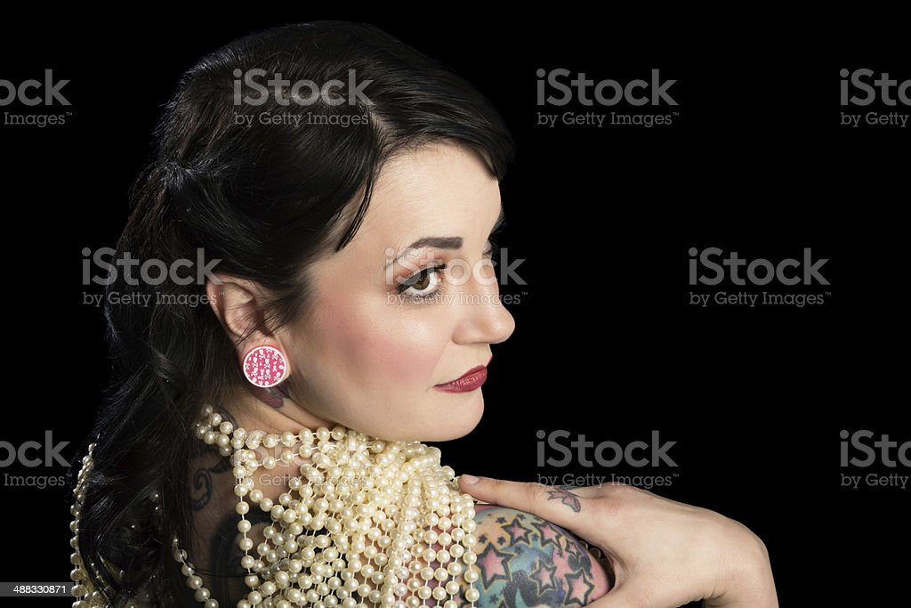 Rear view profile of woman in pearls. royalty-free stock photo